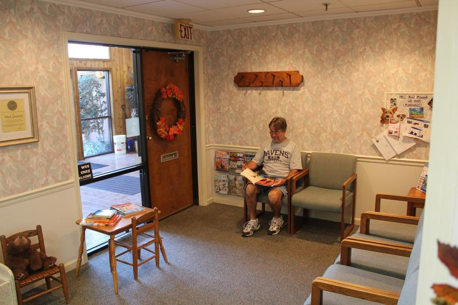 A patient relaxes in the waiting room just prior to an appointment - Dr. Mark C. Gladnick, DDS - Wilmington, DE